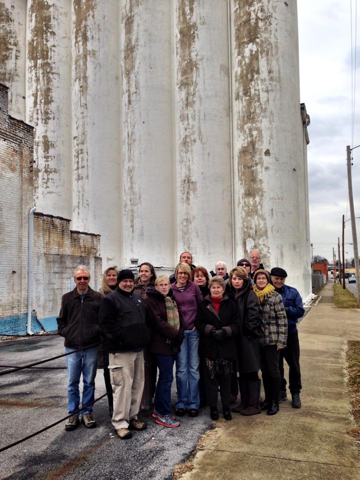 Jodi (center, in purple) with other activists in front of the Model Mill.