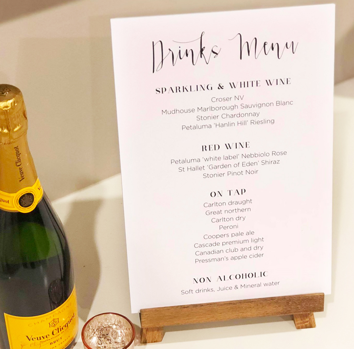 Drinks Menu for an Engagement on wooden easel