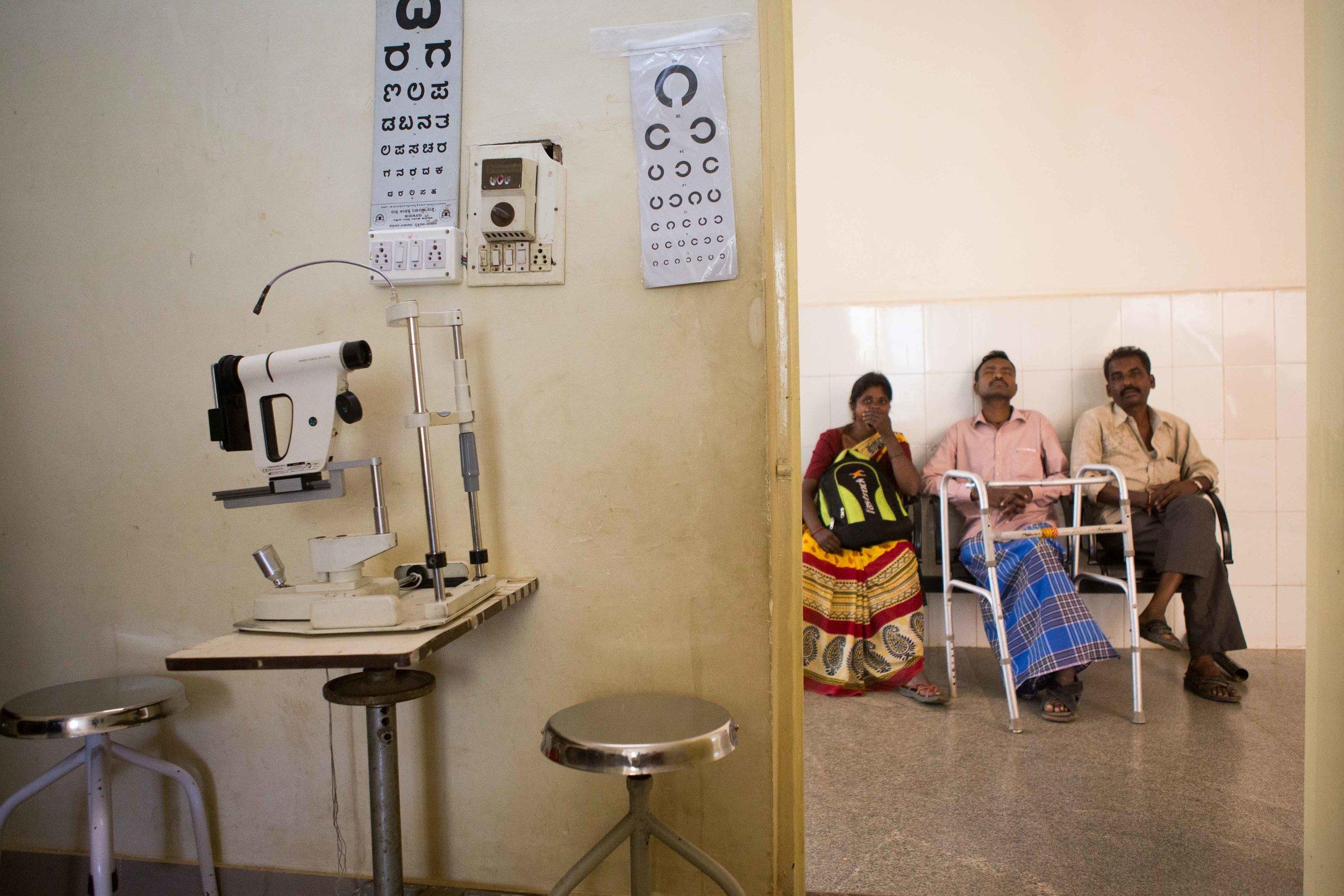 A handicapped person with vision loss waits for his retina examination. District Hospital Tumkur, Karnataka