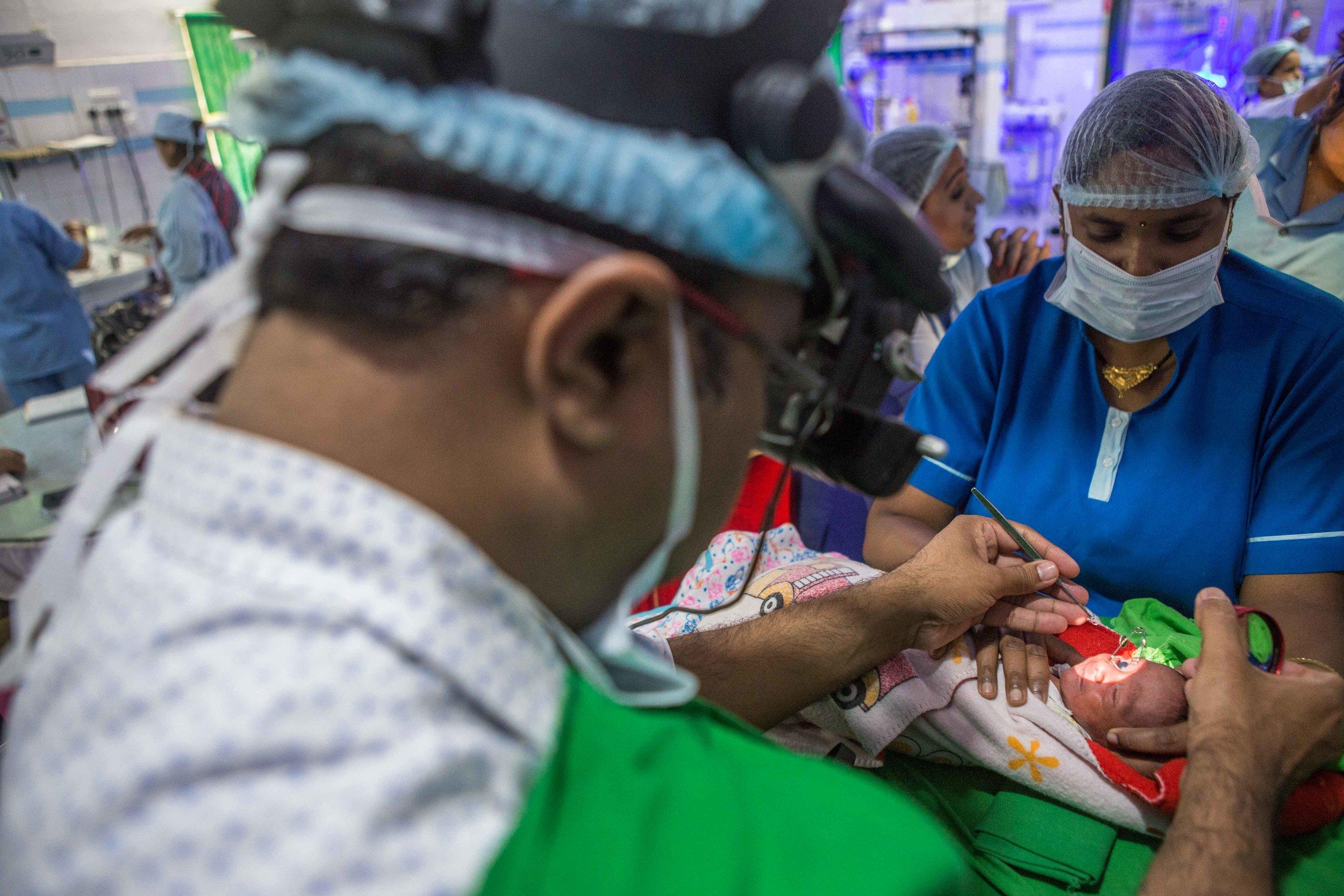 A doctor screens a baby for ROP. NICU Cuttack, Orissa