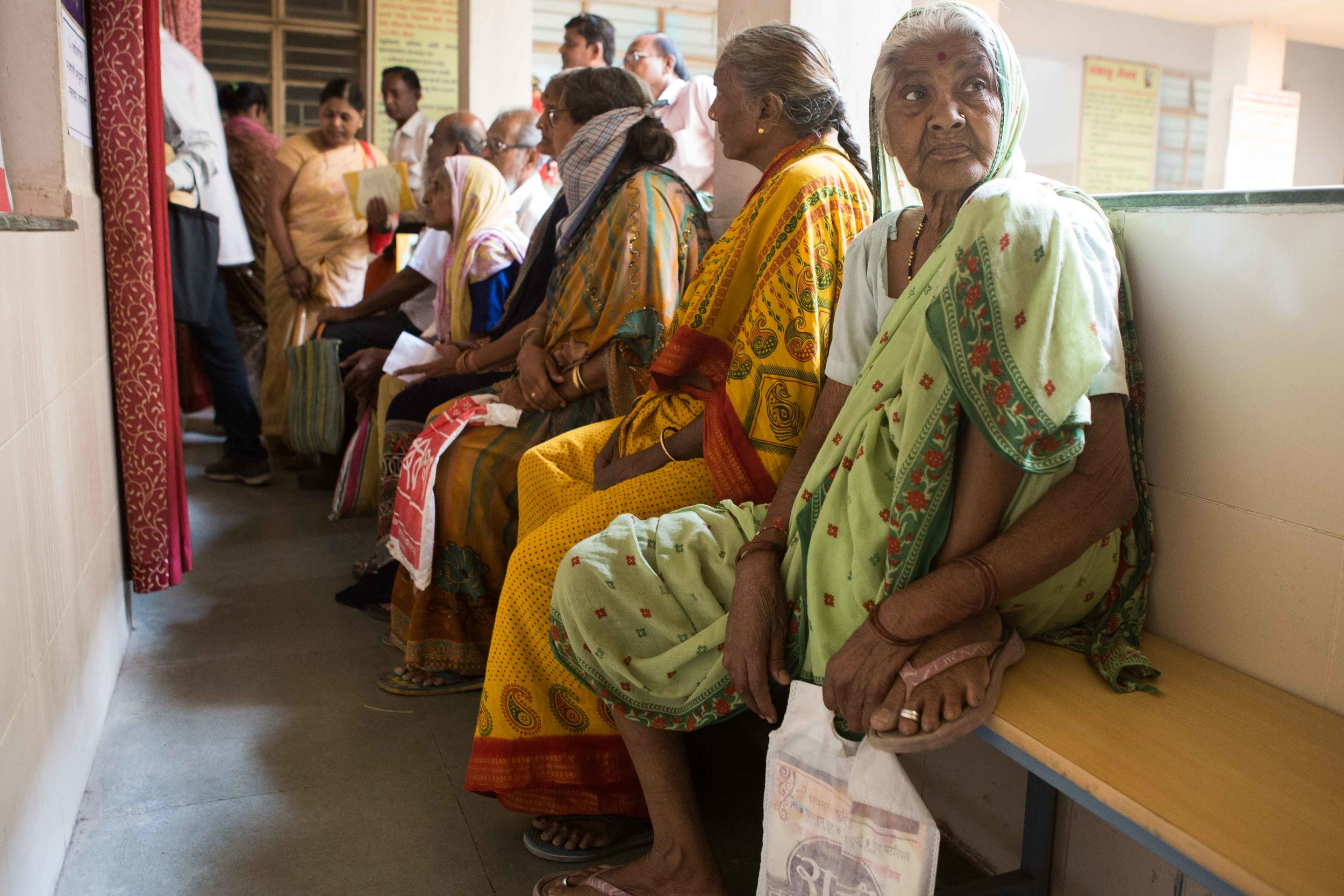 Elderly waiting for their turns to get screened at the Primary Healthcare Centre in Wardha, Maharashtra