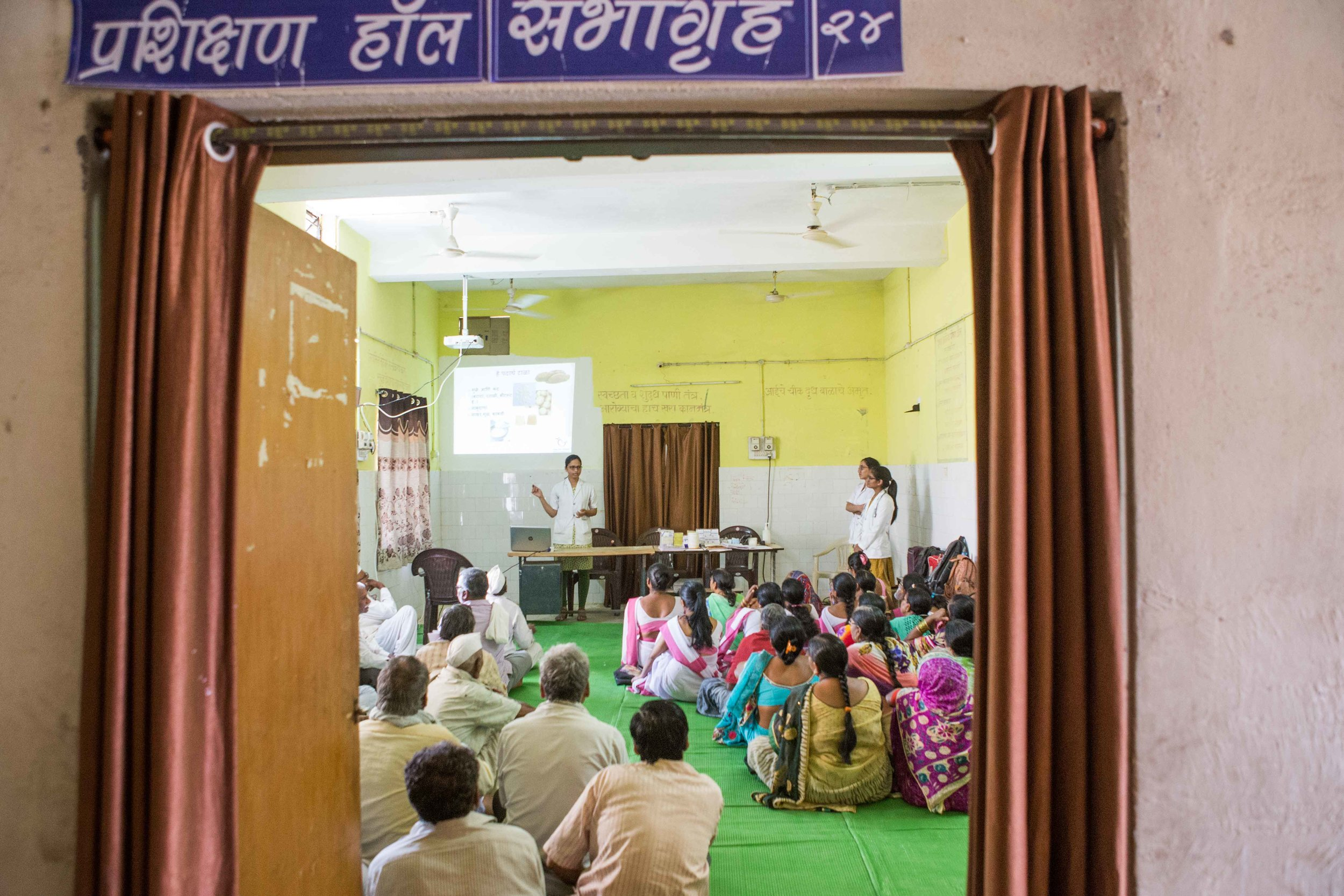 Asha workers and nurses holding a camp for the elderly to spread awareness about Diabetic Retinopathy. PHC, Wardha, Maharashtra
