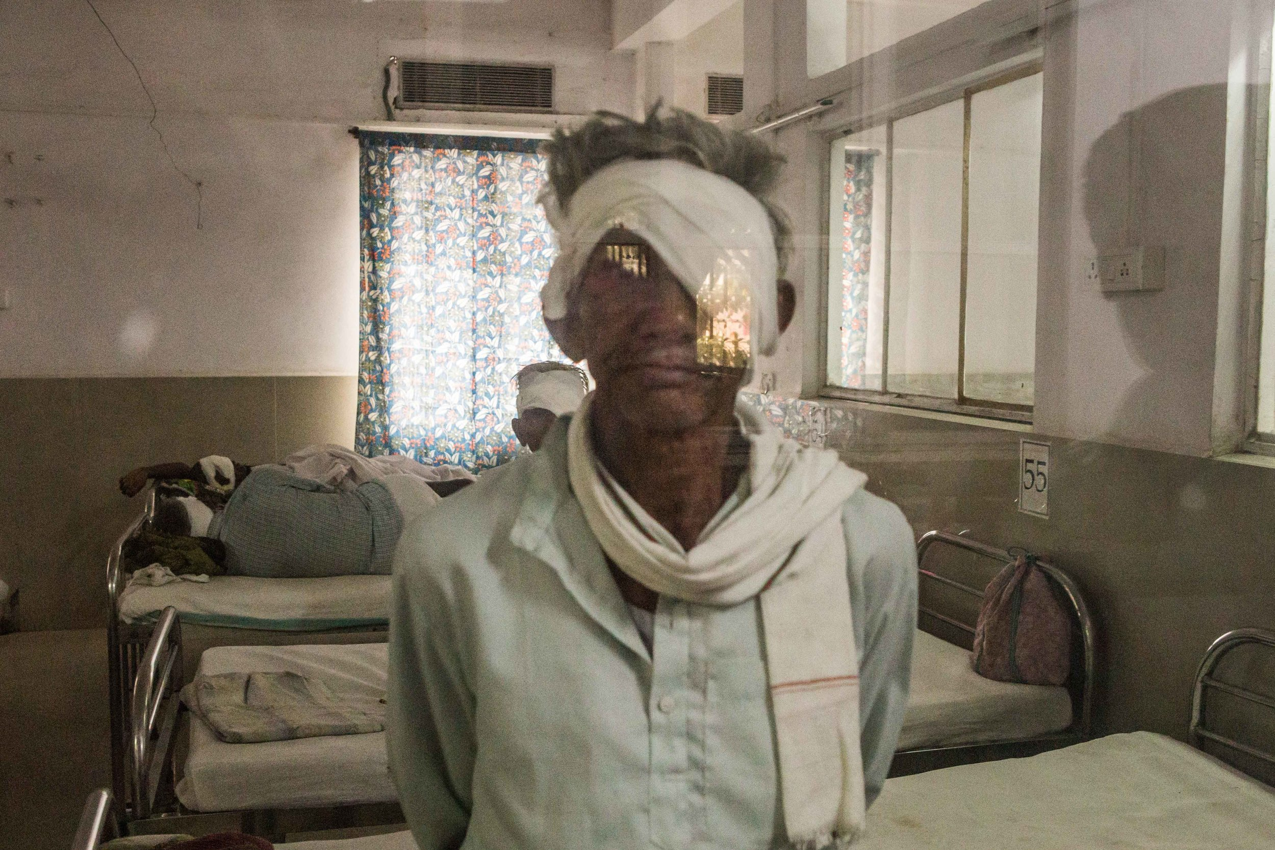 A patient waiting for his discharge after an eye operation. District Hospital Wardha, Maharashtra