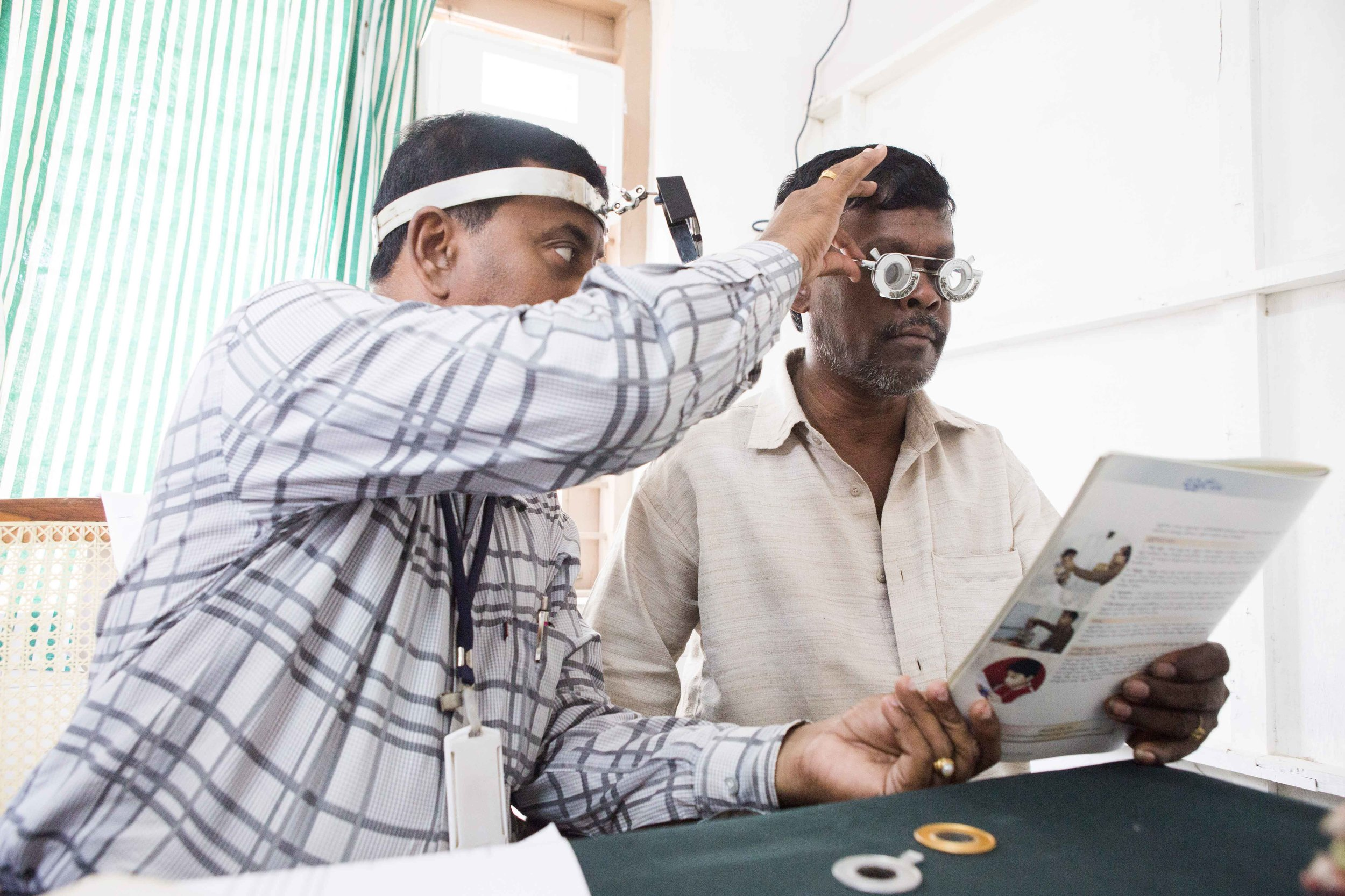 Optometry test in progress to detect extent of vision loss, Primary healthcare Centre Vizianagaram, Andhra Pradesh