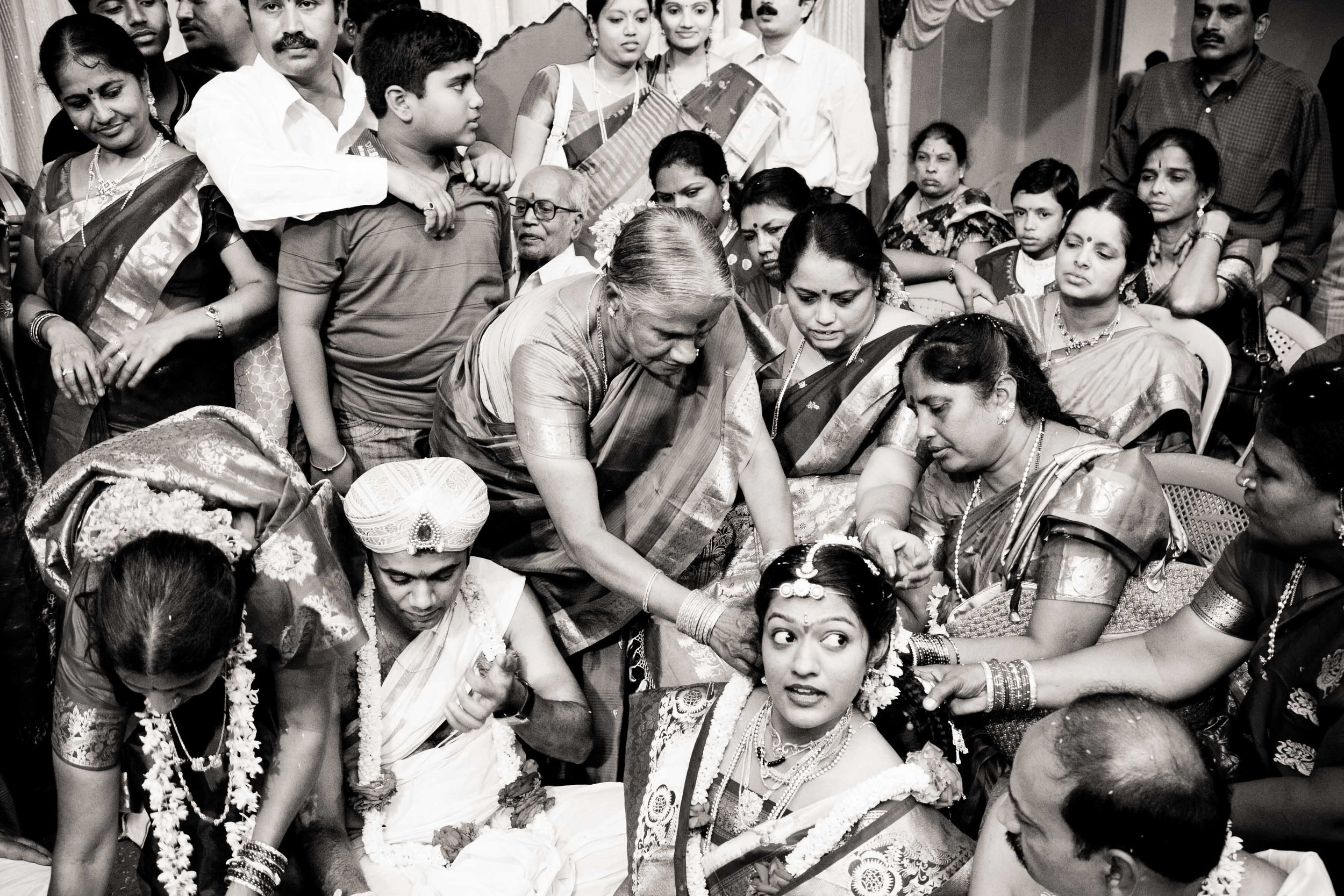 Wedding photography is all about deriving meaning in chaos, In this pic, Vidhatri (the bride) looks to her aunt while each person in the frame is in their own world. In a fleeting second the frame is gone forever and a new one emerges with a different emotion and a different meaning.