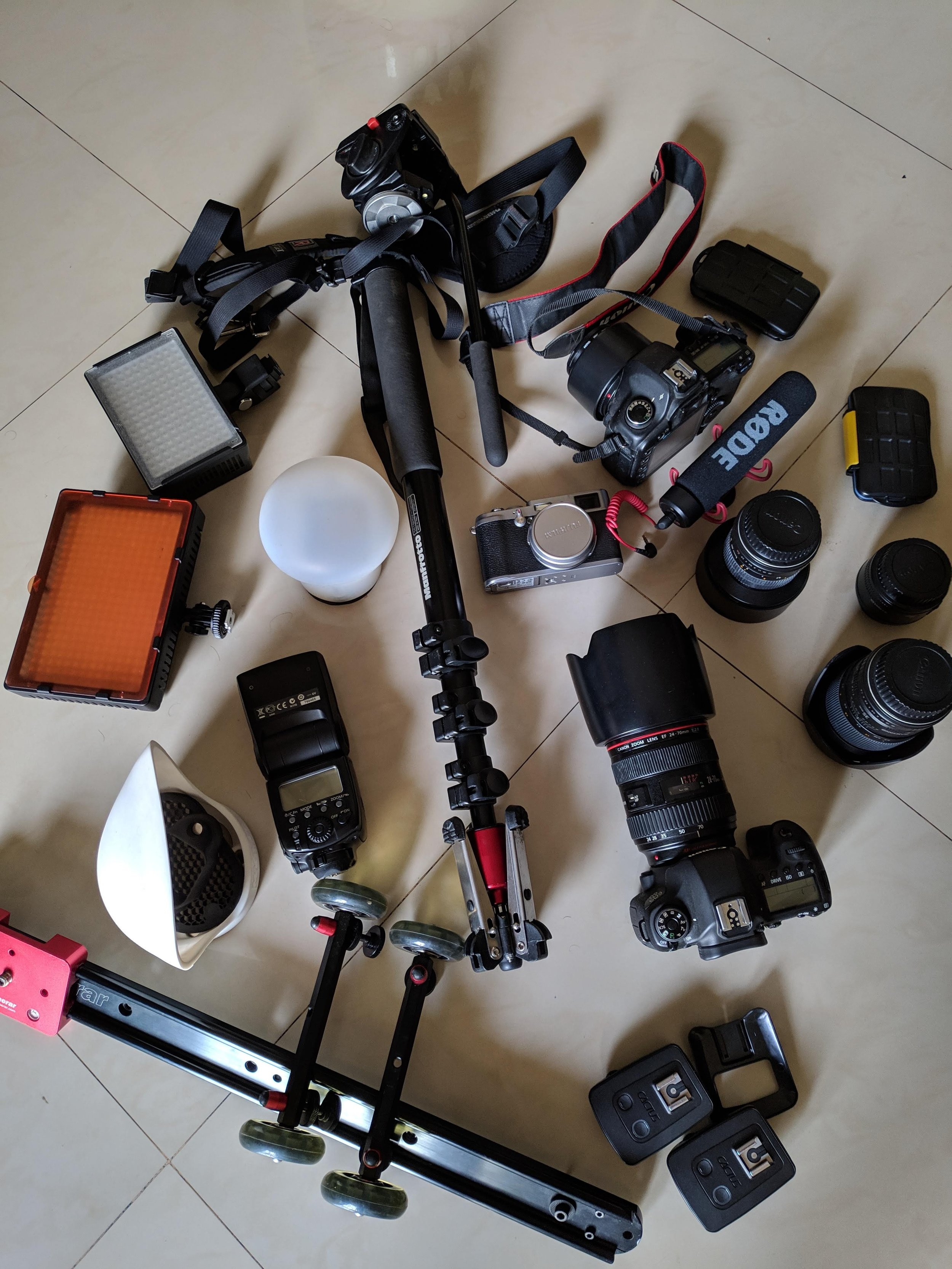 Enough gear to shoot nice and easy,  Canon  &  Fuji  cameras , A few L series Canon lens,  a Magmod flash system ,  Manfrotto Monopod , a slider, a couple of led lights, triggers,  a rode mic  and we are good to roll