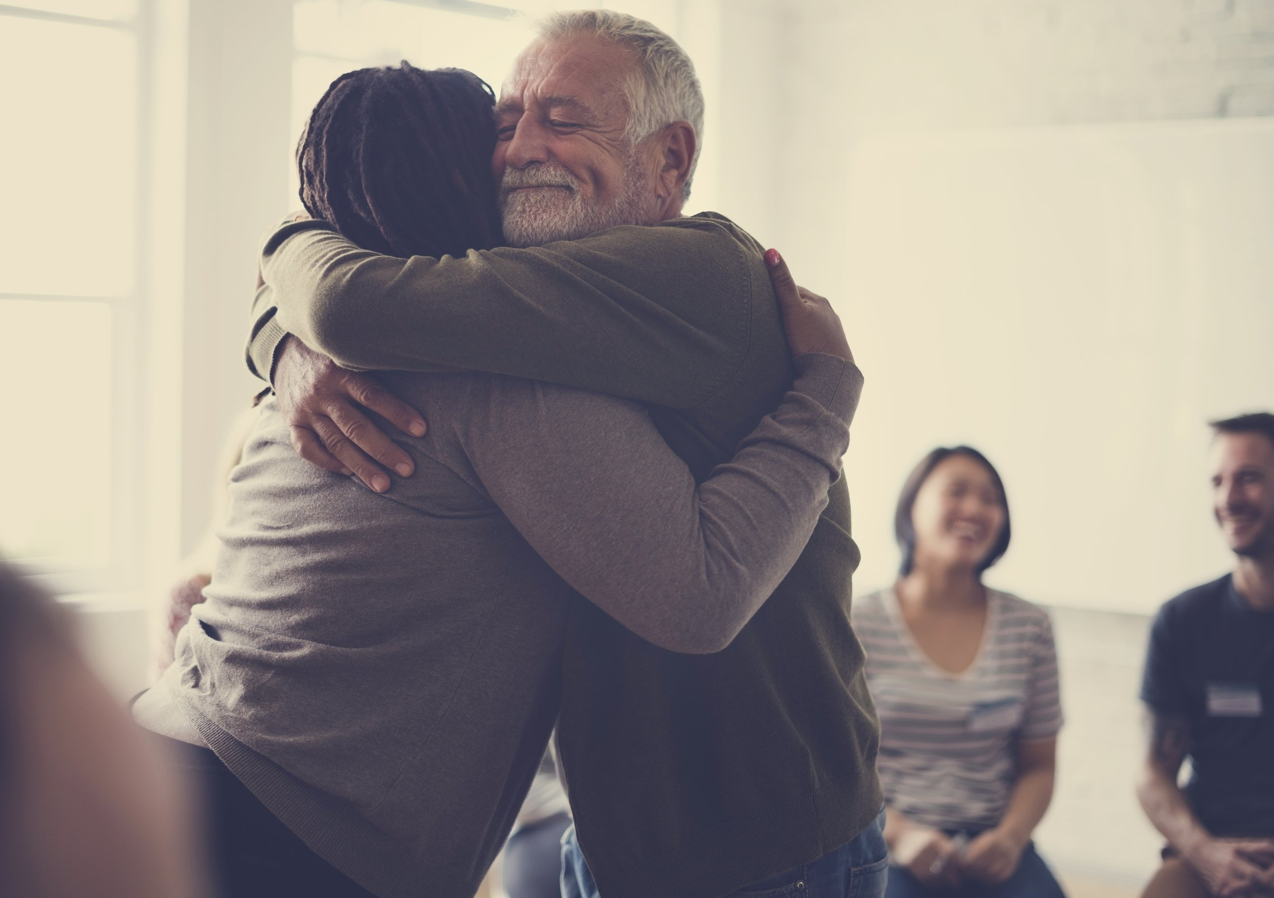 bigstock-Old-guy-consoling-a-woman-with-158607830.jpg