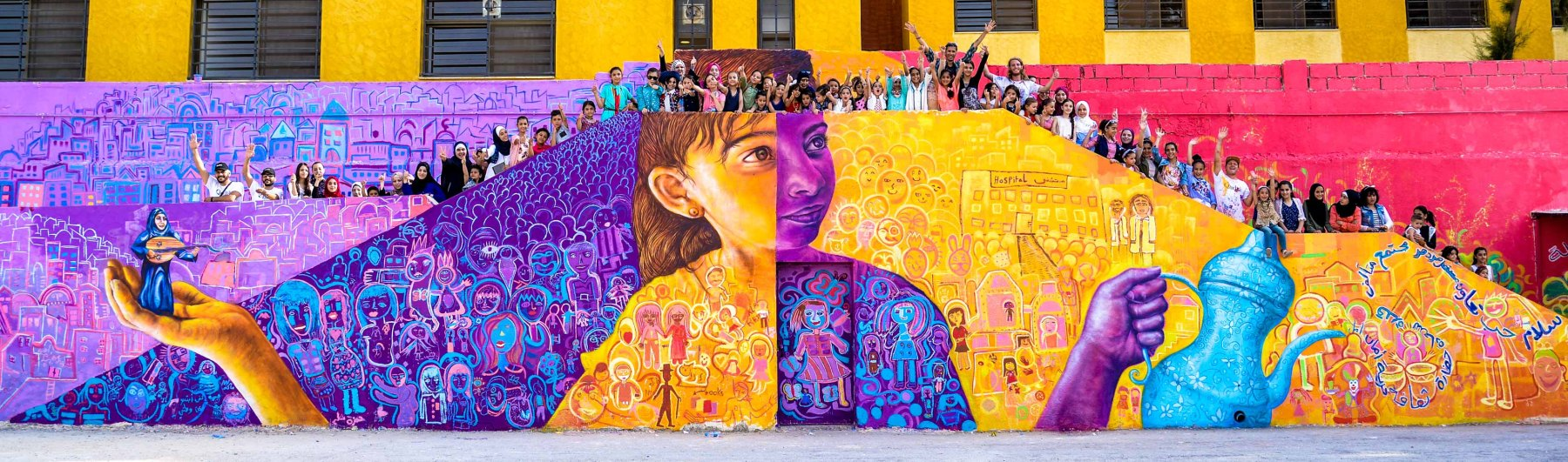 Joel Artista - Group mural projects for refugee communities led by artist Joel Bergen (co-founder of Artolution, below)