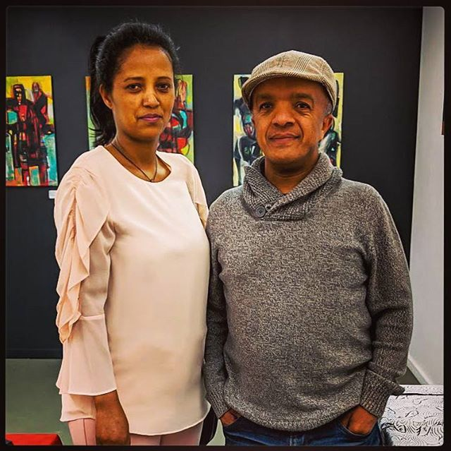 "Just before doors opened on the ""Without Borders"" exhibition hosted by BallardWorks, we were lucky to get a rare photo of featured Eritrean artist, Abraham Awalom with his beautiful muse (and wife) Tsega. Such a fun opening night! *