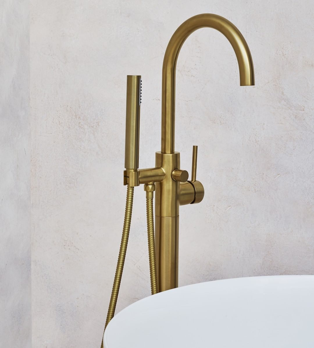 Floor standing bath taps in brushed brass.jpg