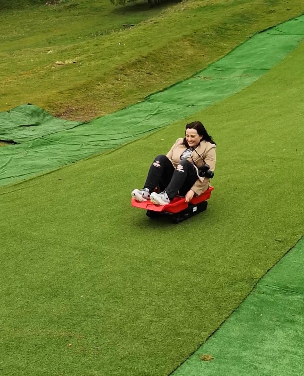 karen grass sledging.jpeg