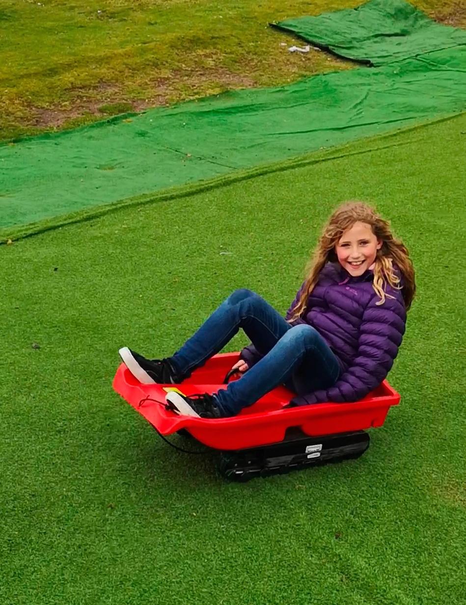 Eilidh grass sledging.jpg