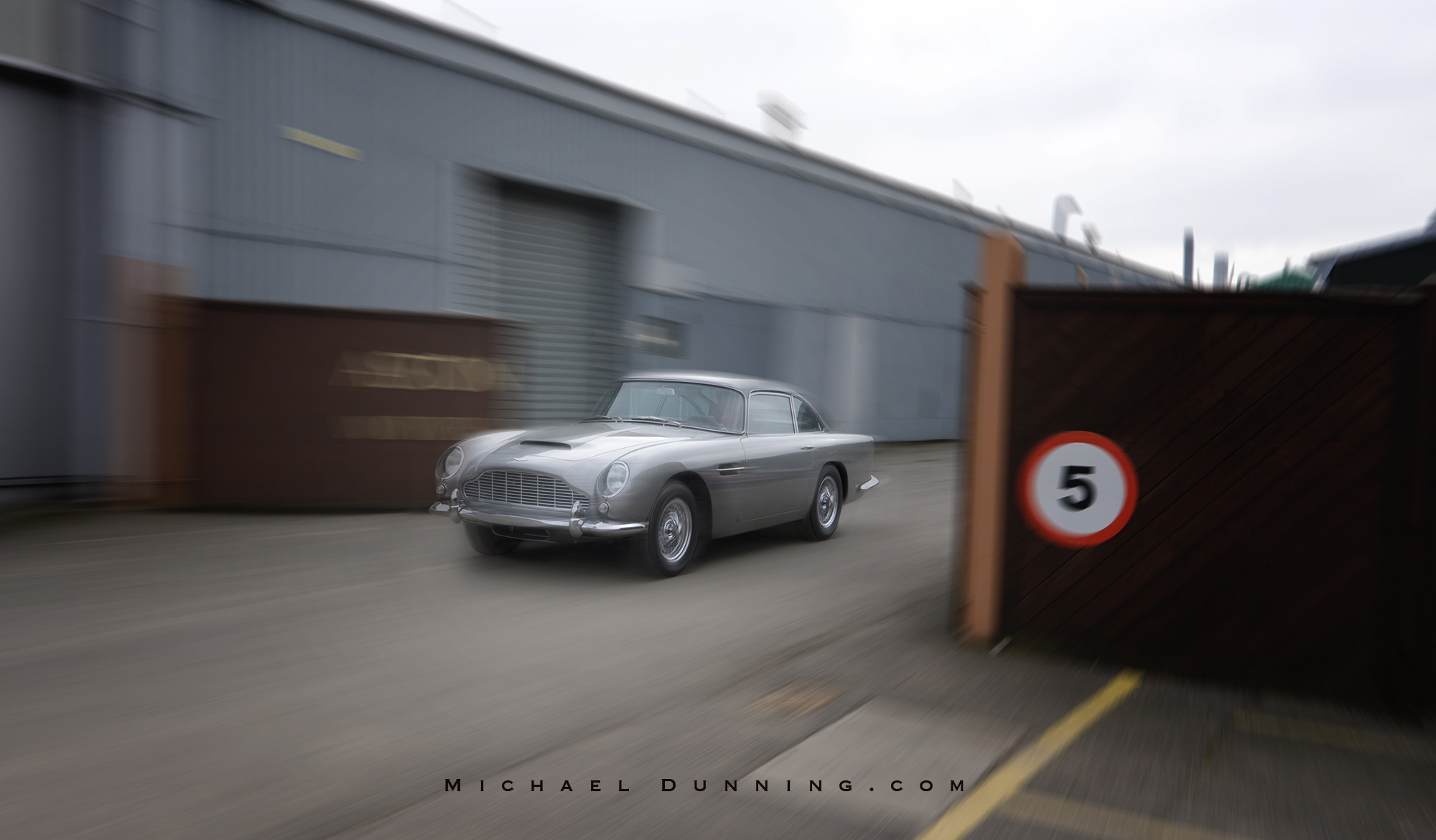 Hilary in DB5 at Aston Works.jpg