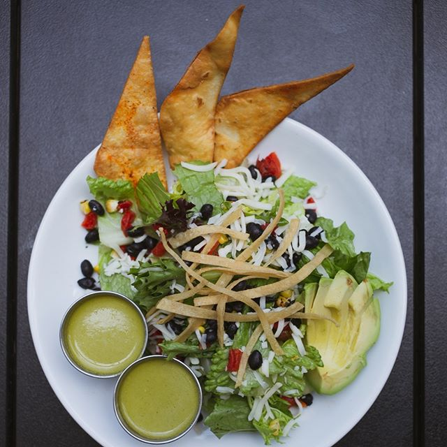 Our Southwest Salad has all the yummy fixins you could want on your greens! House made cilantro lime vinaigrette is served on the side. Make it Gluten Free without the tortilla strips or chips! Come grab one today.