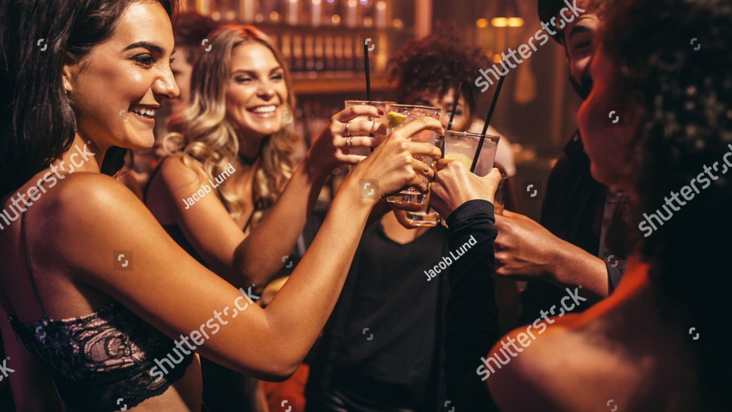 stock-photo-group-of-young-people-with-cocktails-at-nightclub-best-friends-partying-in-a-pub-and-toasting-574600165.jpg