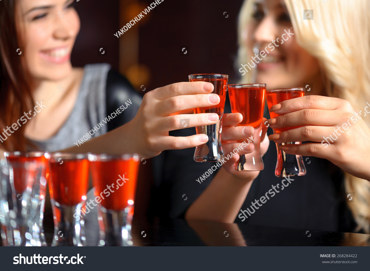 stock-photo-friendship-forever-selective-focus-on-three-shots-with-red-beverage-and-smiling-girls-in-blurry-268284422.jpg