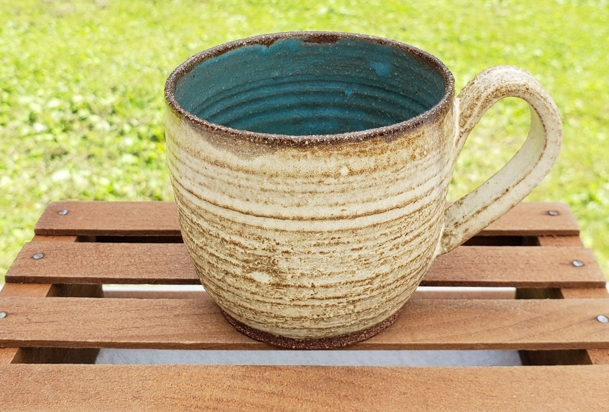 small mug - cream and turquoise glazecourse red clay body10 ounce capacity$25#SM005