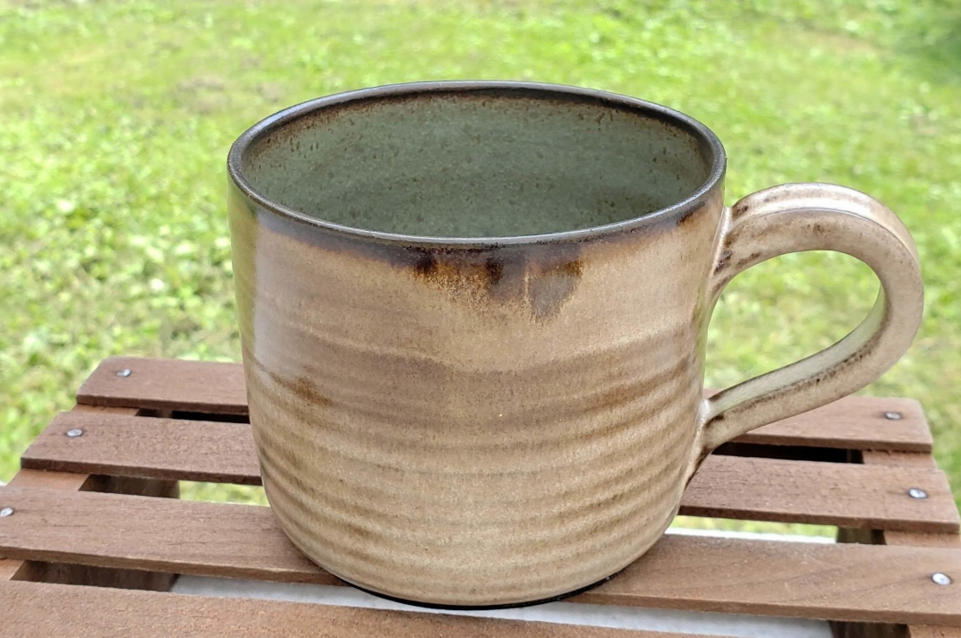 medium mug - cream and sage glazedark brown clay body14 ounce capacity$26#MM002