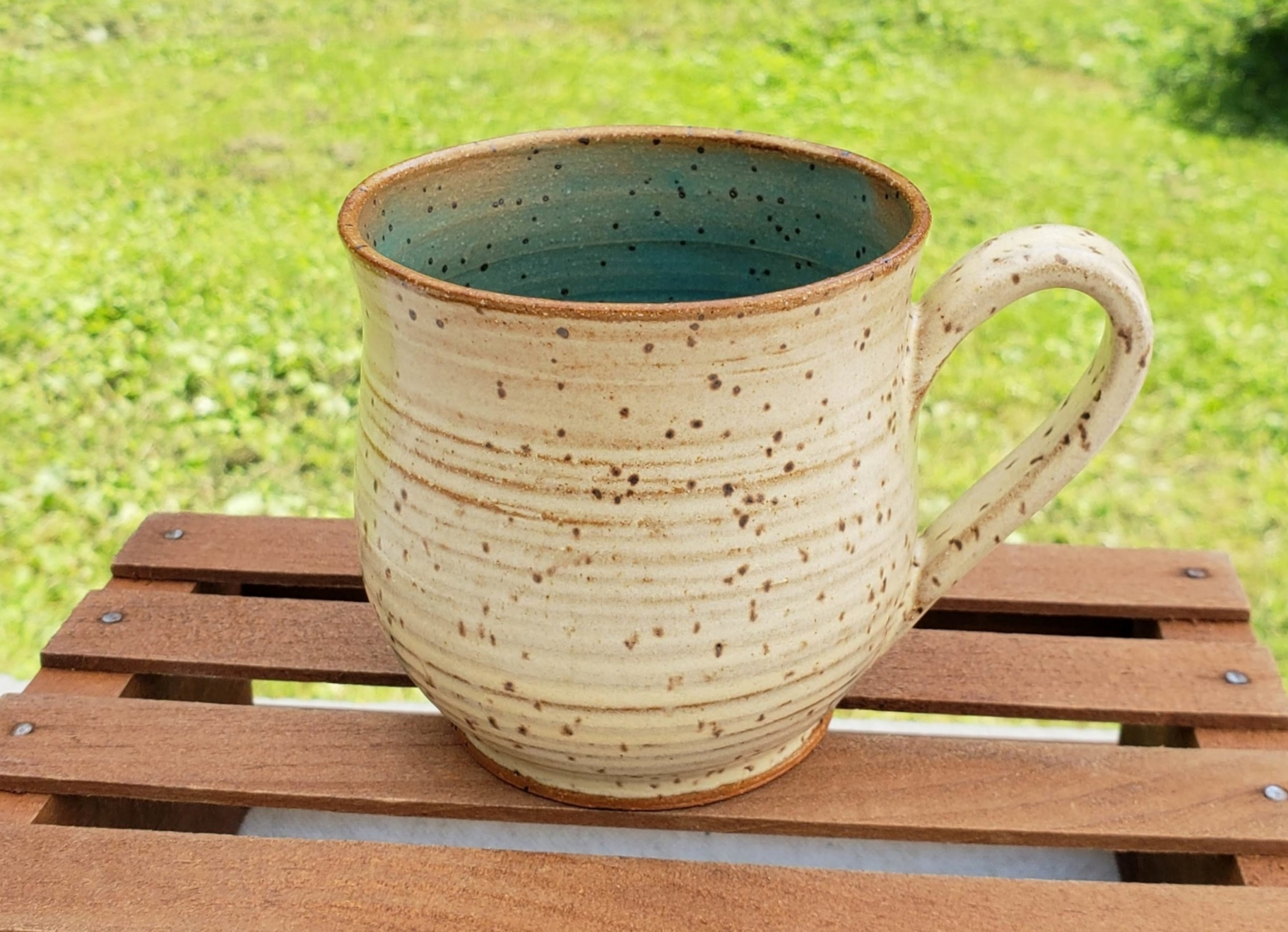 medium mug - cream and turquoise glazespeckled tan clay body11 ounce capacity$26#MM007