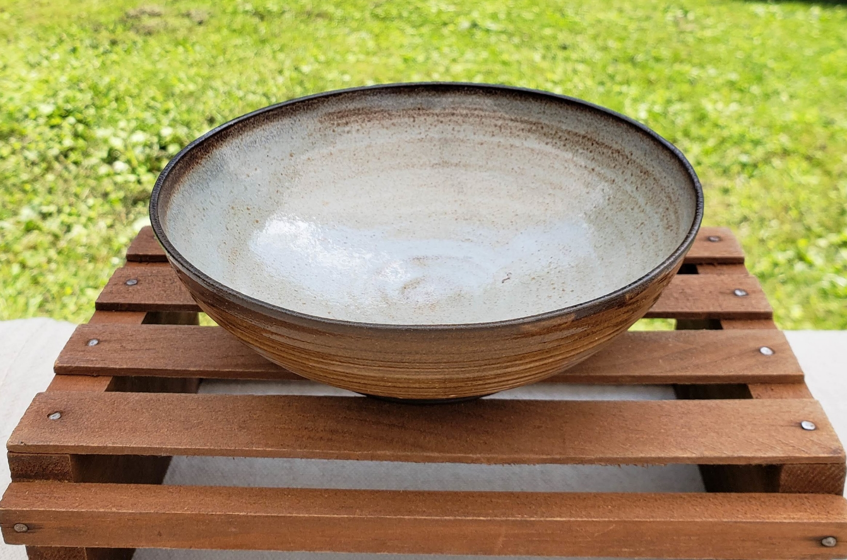 small bowl - cream and pale blue glazedark brown clay body5 3/4