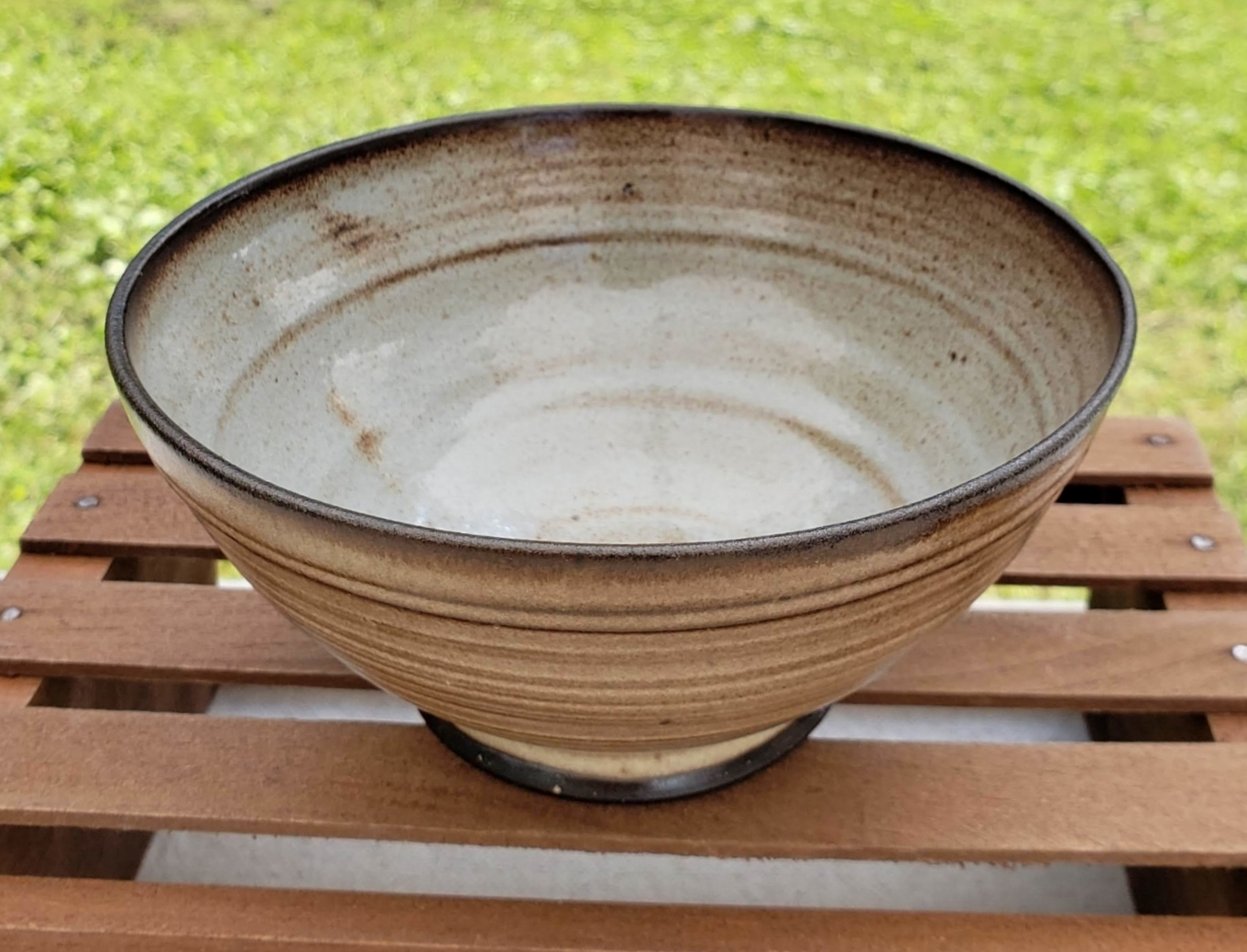 small bowl - cream and pale blue glazedark brown clay body5 1/4