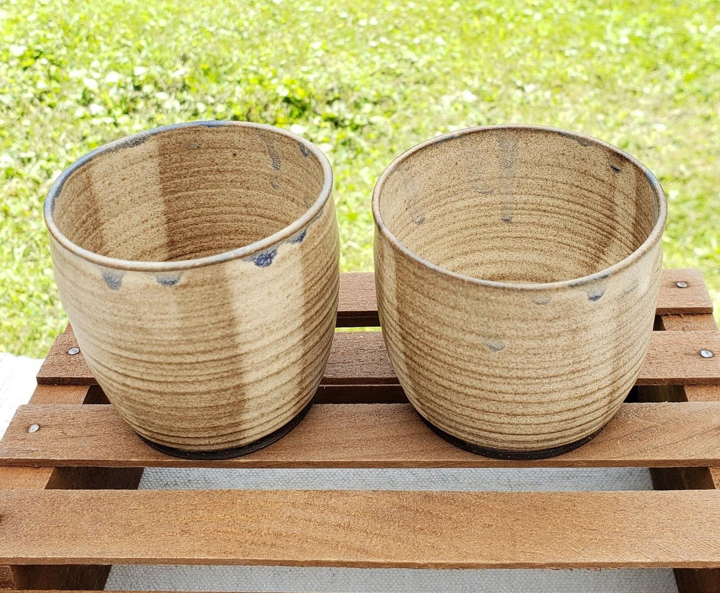 tumblers - cream and cobalt glazedark brown clay body6 ounce capacity$17 each$32 for set#ST001 (L) #ST002 (R)