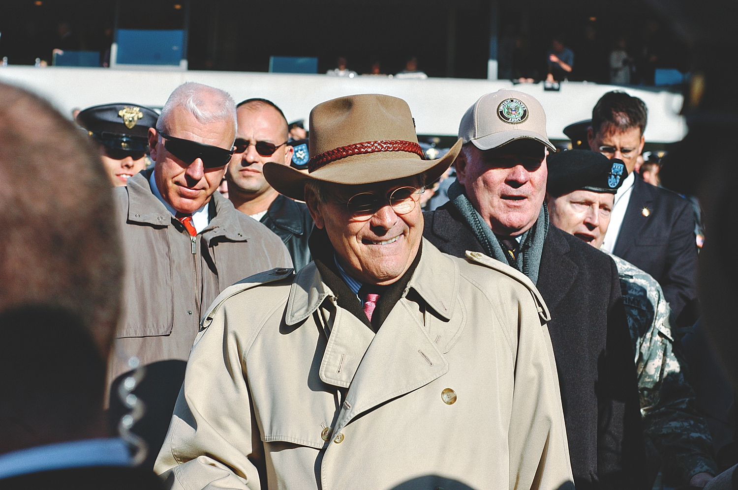 12-donald-rumsfeld-walks-down-stadium-during-army-navy-game.jpg
