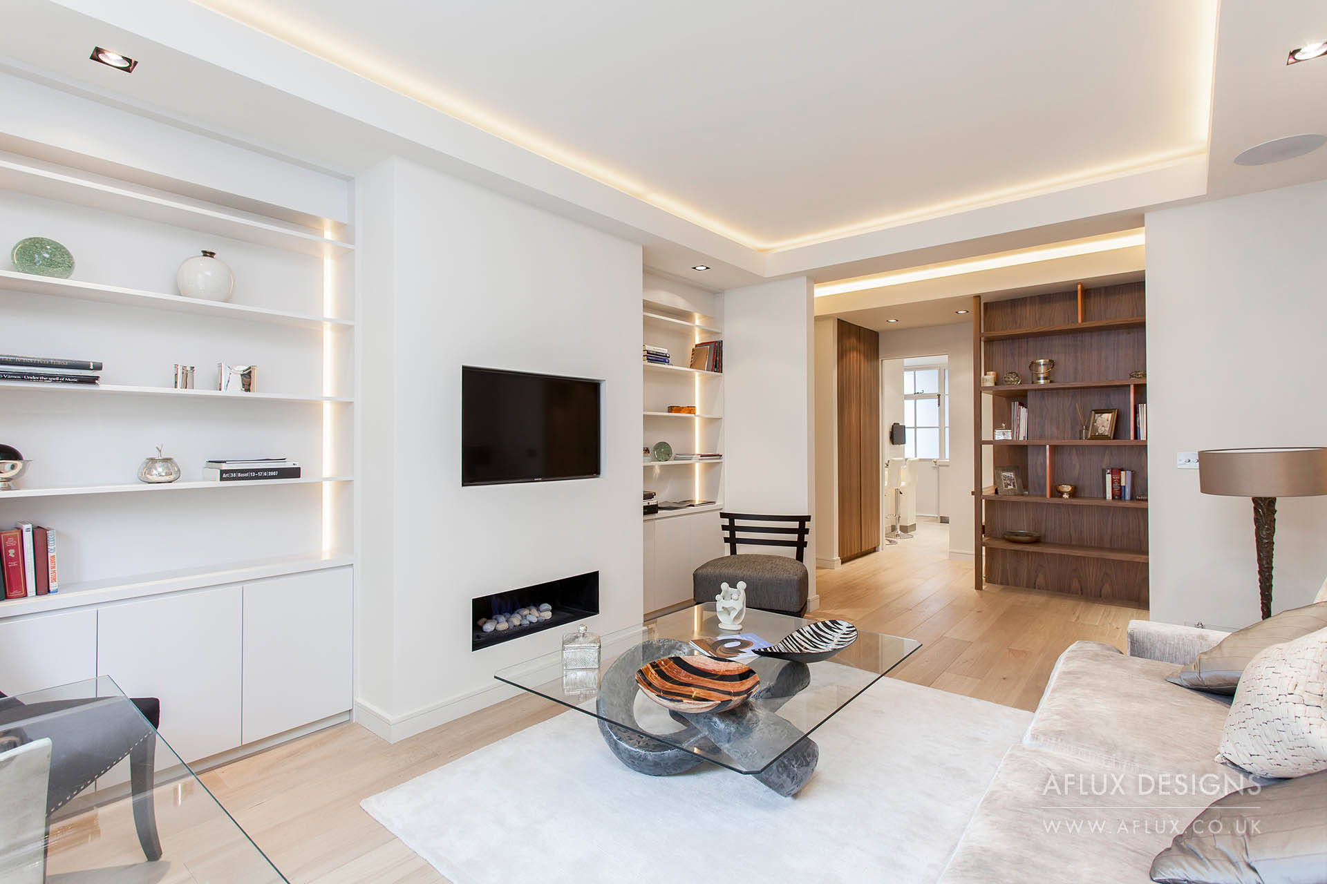 Portland Place - LONDON W1BA ground floor flat in a portered building in Marleybone which had not been touched for over thirty years turned into a bright and spacious two bed, two bath pied a terre. Low ceilings allowed for recessed lighting and bespoke joinery throughout maximised storage.