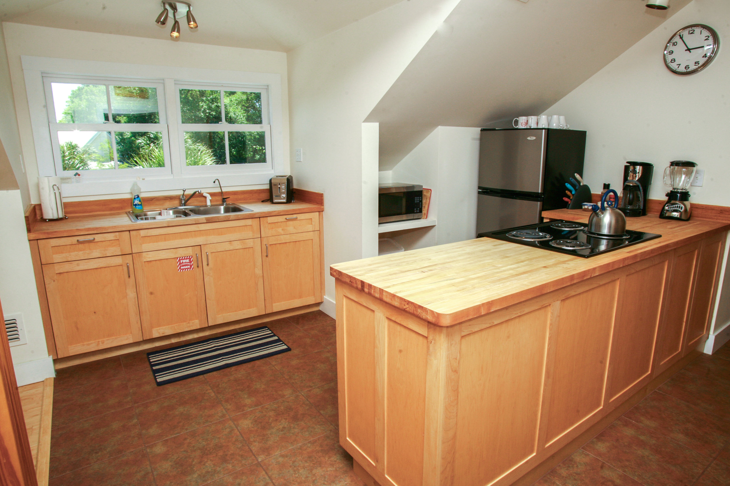 Fully equipped kitchen with loads of sunlight! All custom cabinetry.