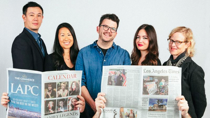 Los Angeles Times Food staff (L-R): Lucas Kwan Peterson, Andrea Chang, Peter Meehan, Jenn Harris and Amy Scattergood in the back row; critics Patricia Escárcega and Bill Addison, behind the newspapers, in front. ( Tiffany Roohani )