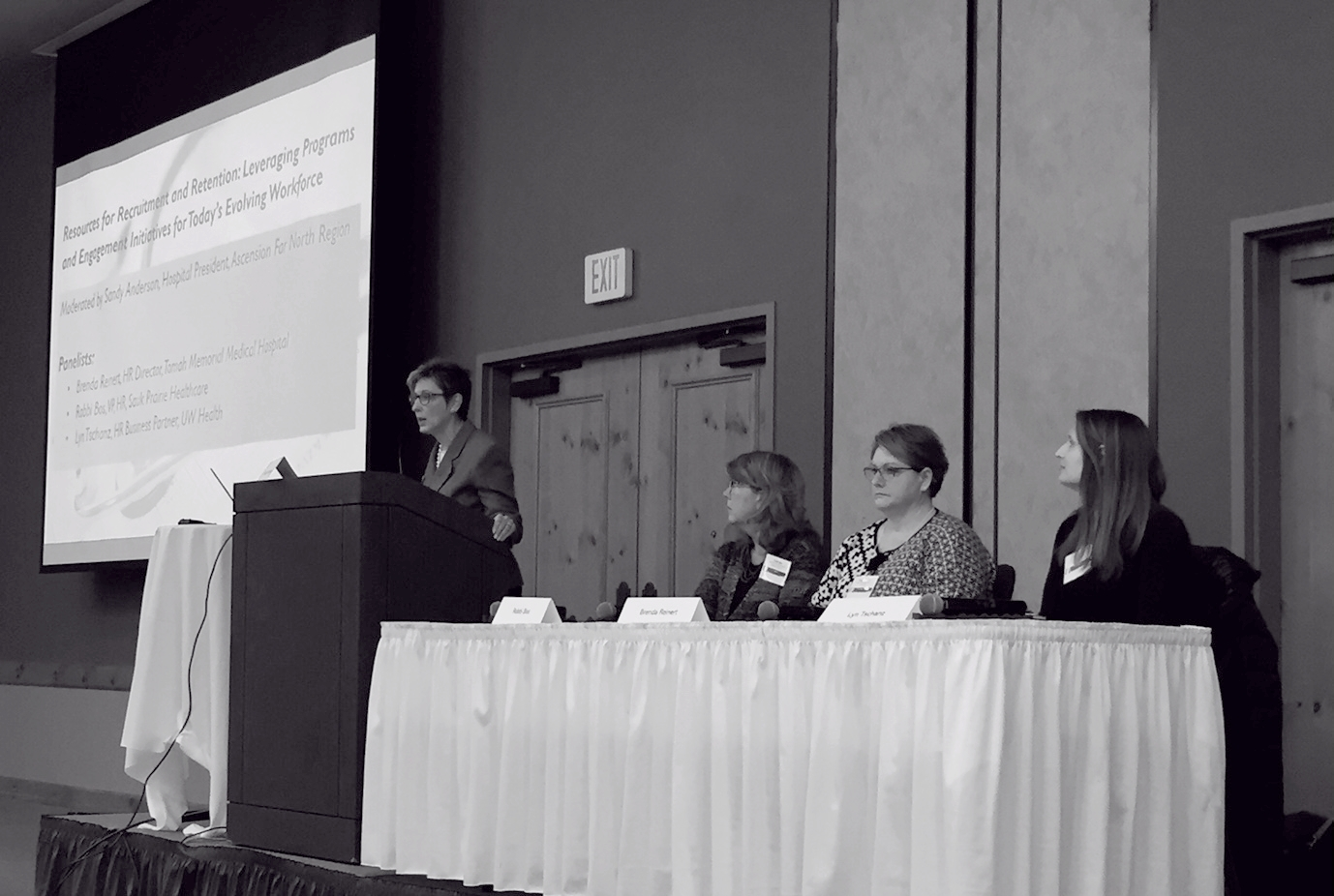 Sandy Anderson (Ascension North), addresses panelists Robbi Bos (Sauk Prairie Healthcare), Brenda Reinert (Tomah Memorial Medical), and Lyn Tschanz (UW Health), discussing provider retention initiatives.