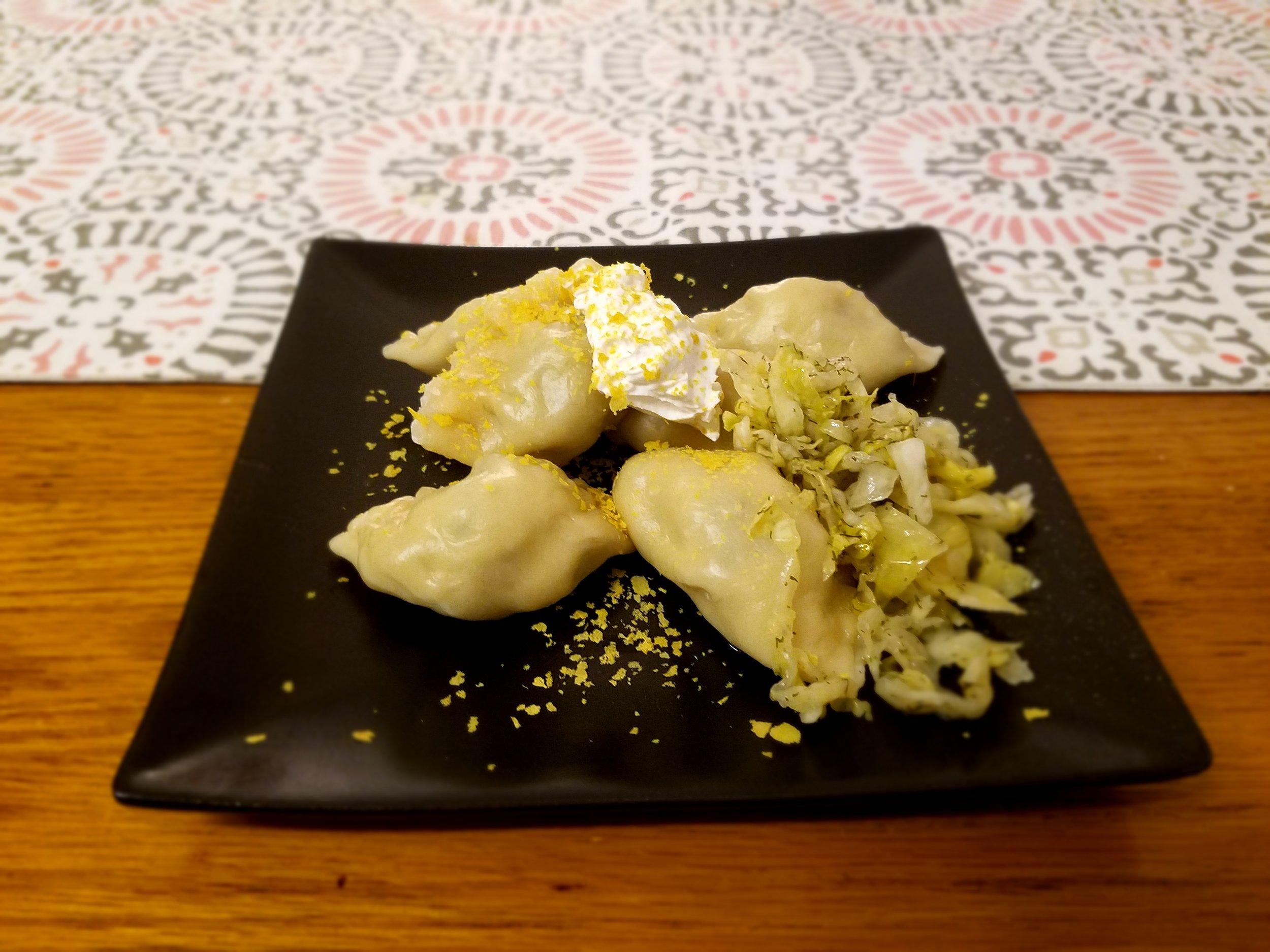 Served with vegan sour cream, nutritional yeast, and dill lemon sauerkraut.