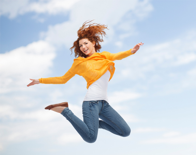 yellow shirt jumping with jeans on.jpg