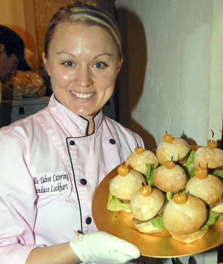 Chef Lockhart with a platter of signature sliders