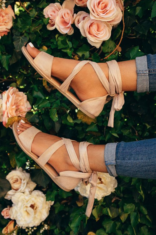 feet in sandals with roses.jpg