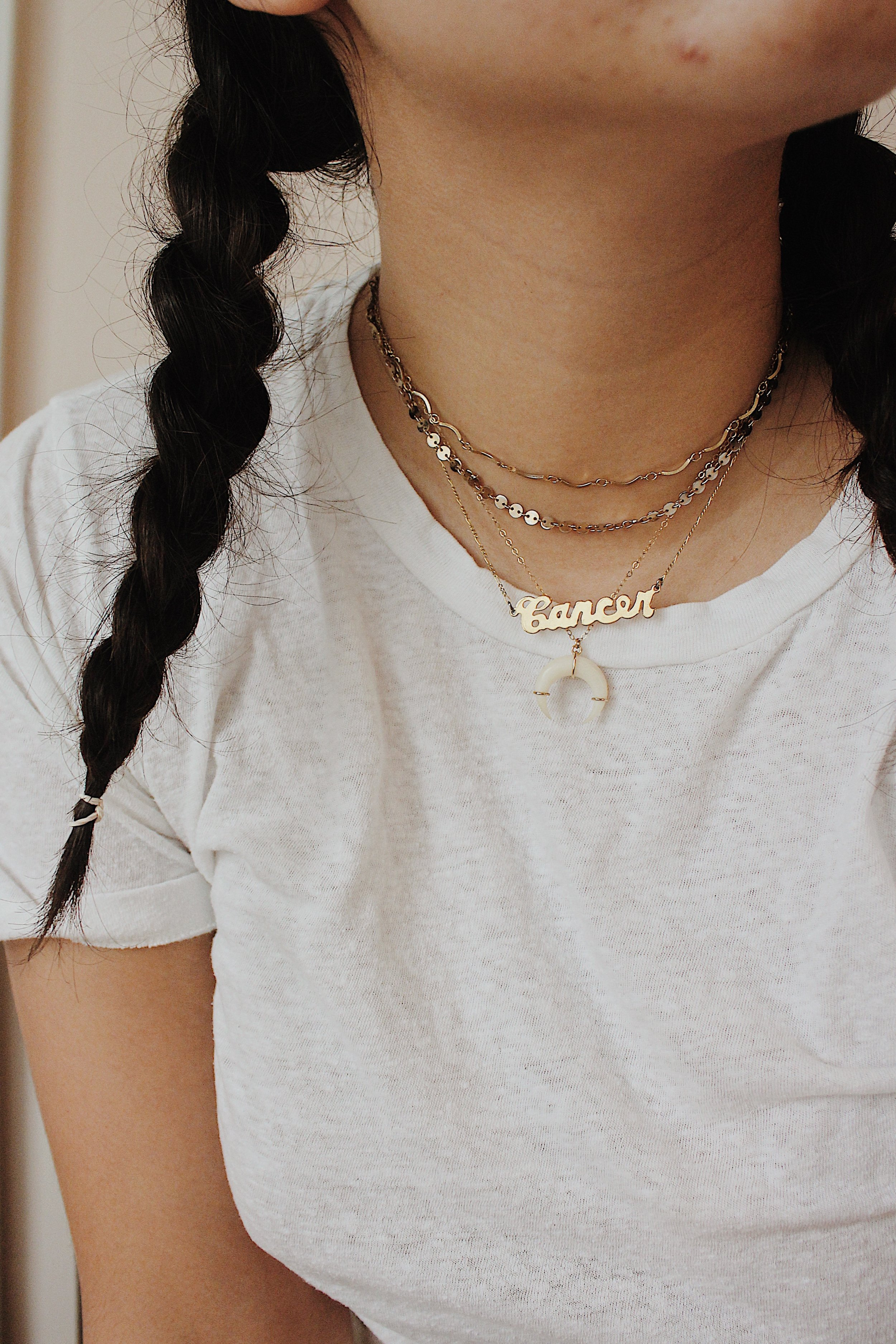From top to bottom: Brooklyn Bleu  Vintage Choker  (unavailable but similar option  here ) // Oceanne  Dot Choker  // Brooklyn Charm  Astrological Sign Necklace  // Lili Claspe  Horn Necklace