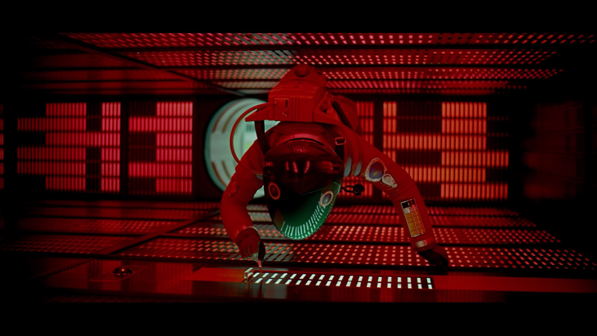 Scene from 2001: A Space Odyssey where the main character floats within an orientation-less room of computer controls.