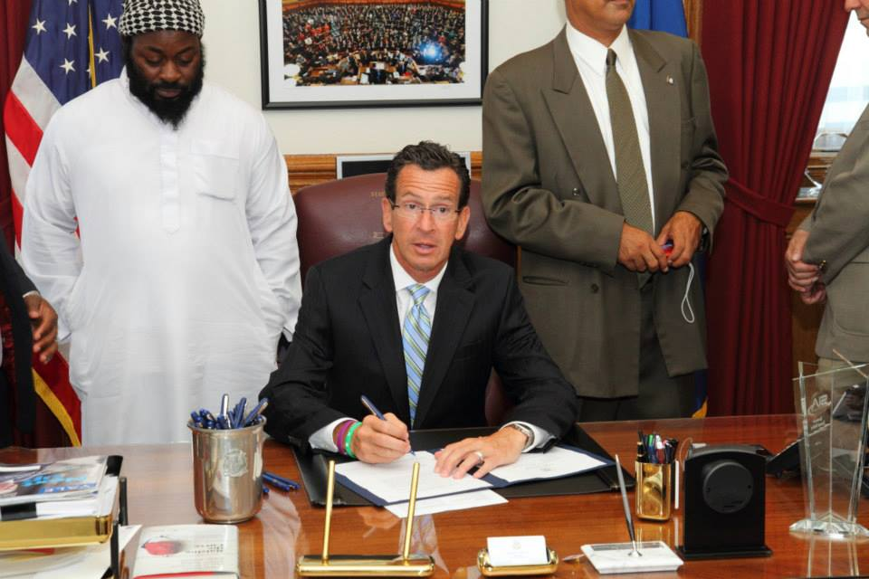 Me, at a bill sign in Gov. Dan Malloy's office of the TRUST Act, a bill that sought to limit cooperation between CT Law Enforcement and Federal Immigration officers, in an effort to limit deportations and reduce fear for undocumented residents to contact police for help. (ca. 2013)