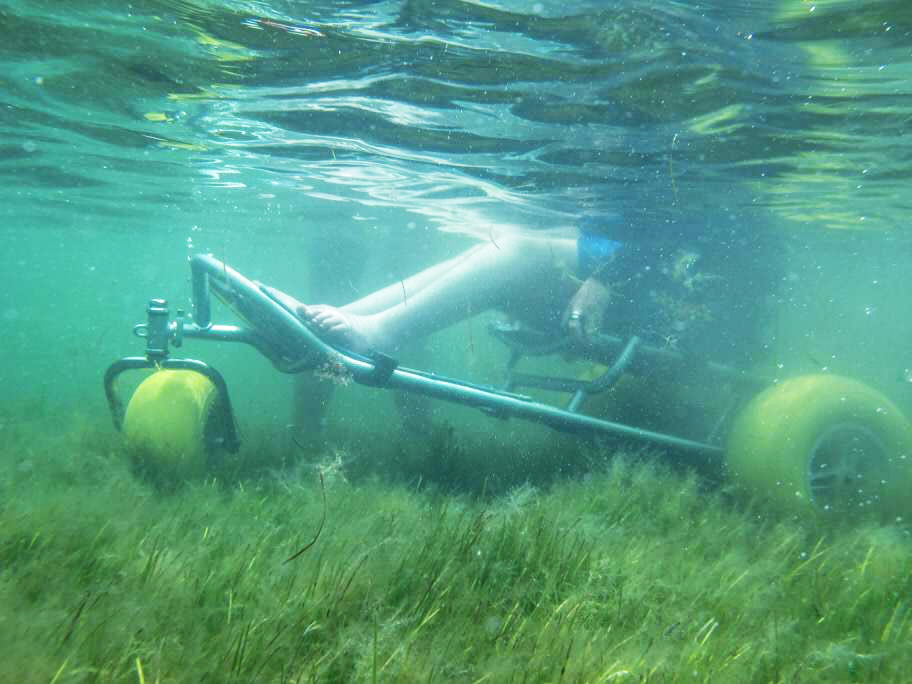 The amphibious  Mobichair  brings divers from the beach into the sea.