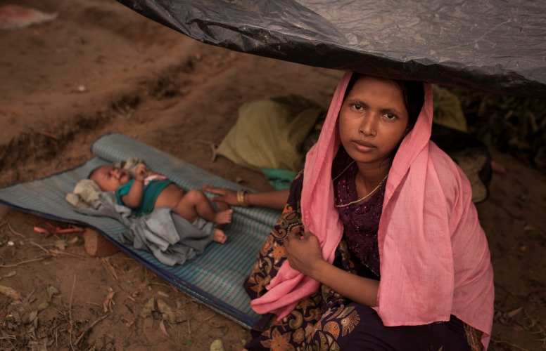 Newly arrived Rohingya refugees rest under a makeshift plastic shelter in Bangladesh, after fleeing violence in Myanmar. Photo: ©UNICEF/Brown