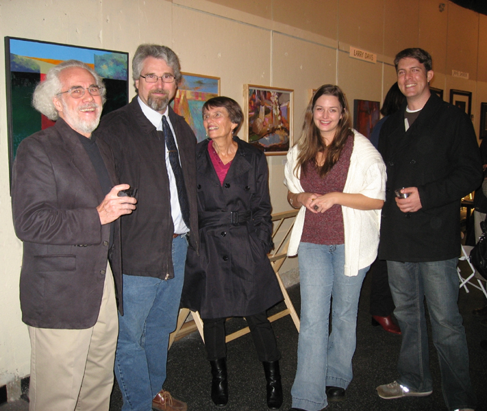 "Guests, fellow artists and gallery staff in conversation at Southlight Gallery's December 8th ""Patron's Party."""