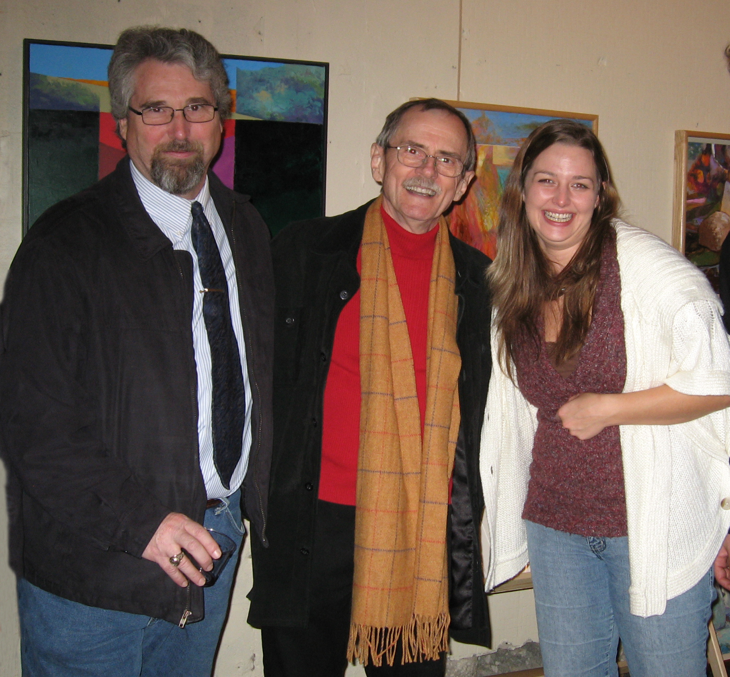 Larry J.Davis (center) with fellow Southlight Gallery artist Tony Wood (left) and Southlight Galerina Erin Walker (right) mark a year of growth and success culminating in the recent Patron's Party.