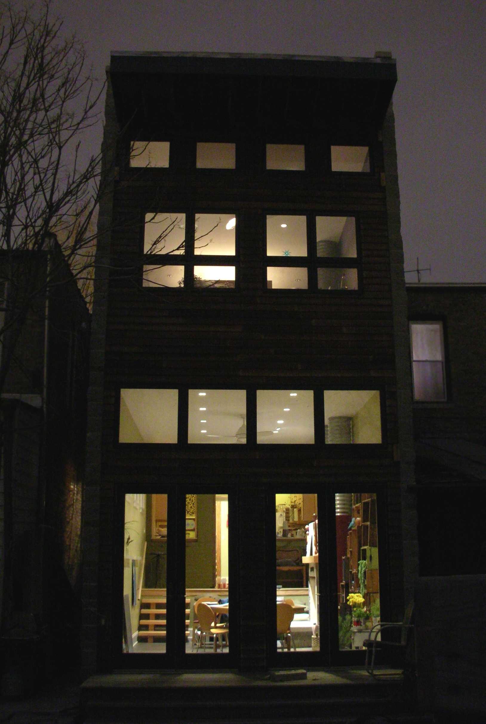 modern addition on 1890s single-family brick rowhouse, french doors, windows