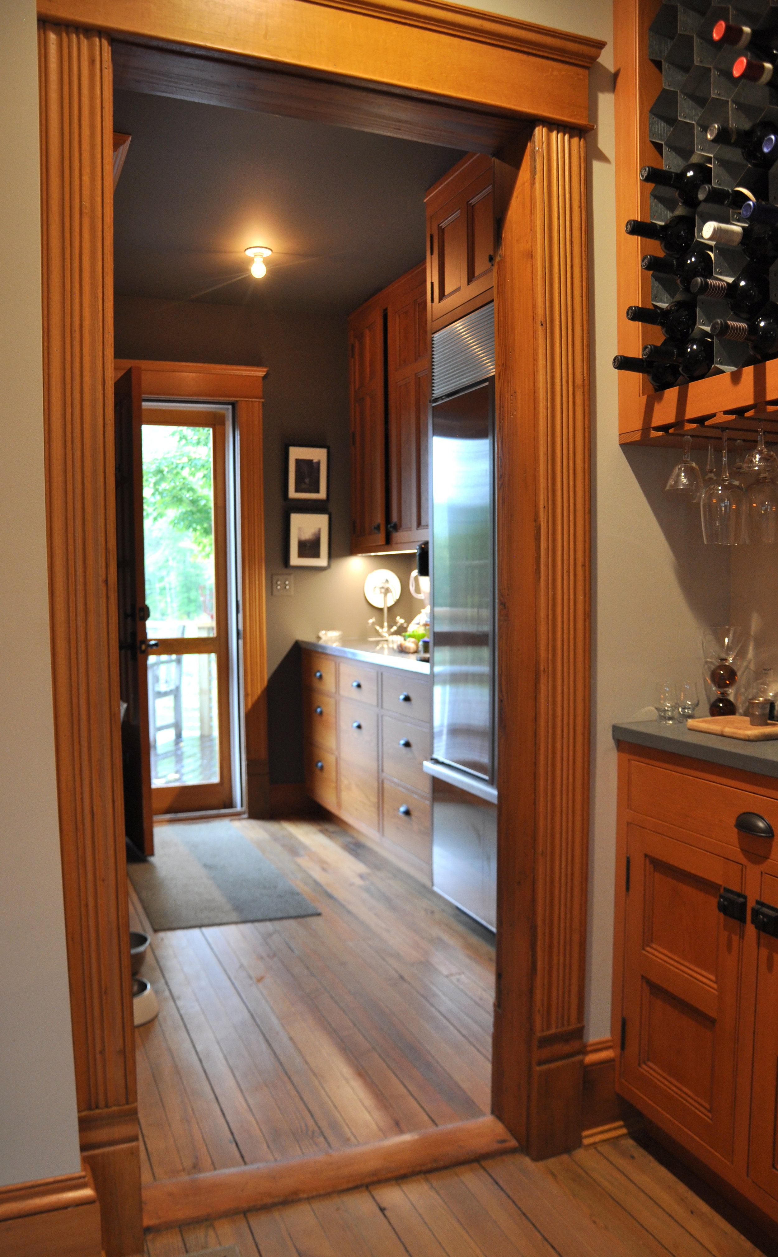 modernized rural farmhouse, residential renovation, open plan, new kitchen, new interior finishes, bar, wine storage, pantry, back door, porch, deck
