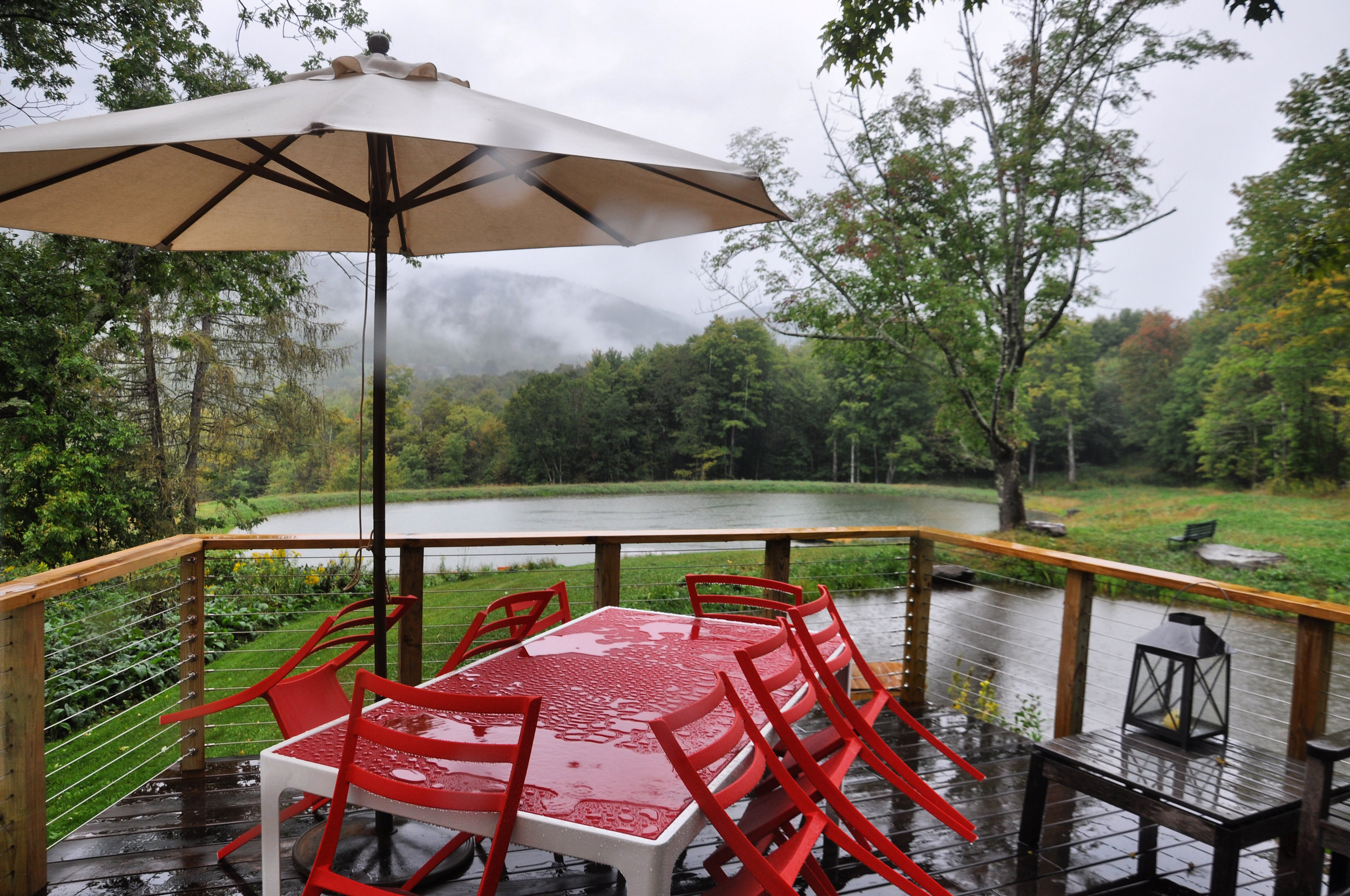modernized rural farmhouse, residential renovation, deck, porch, outdoor dining, mountain home