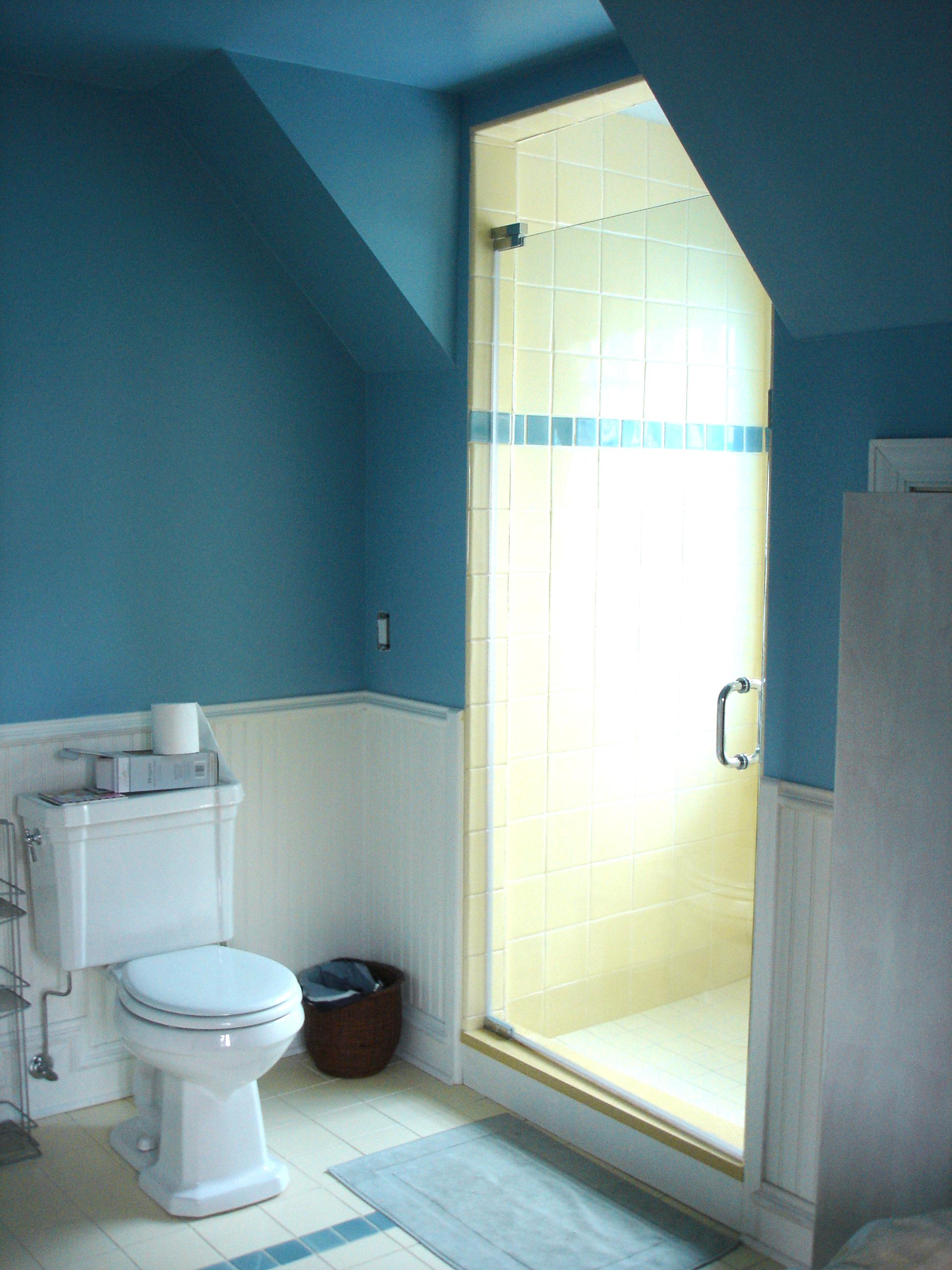 custom single-family residential home renovation, 1920s four-bedoom house, attic bedroom suite, skylight, bathroom