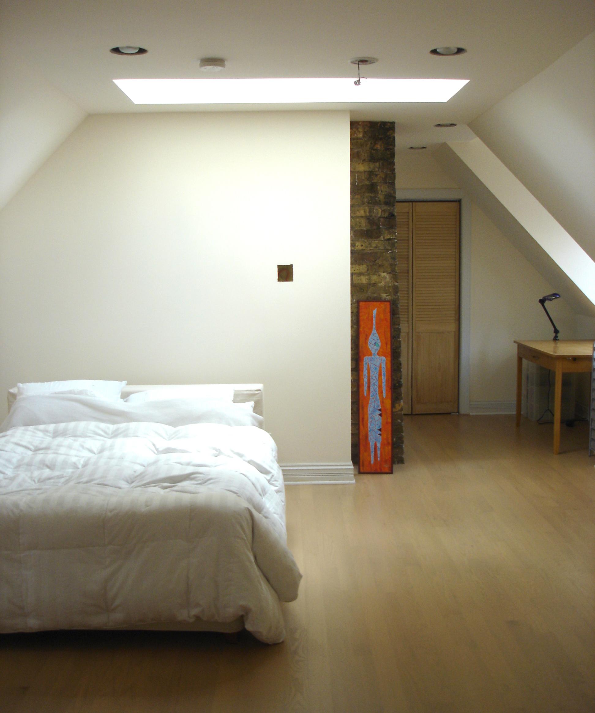 custom single-family residential home renovation, 1920s four-bedoom house, attic bedroom suite, skylight