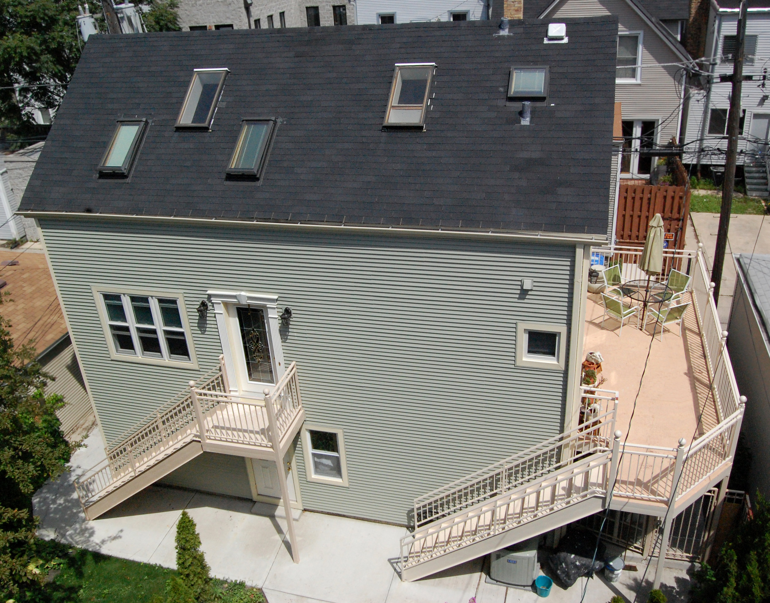 custom gut renovation single-family late-ninteenth-century coach house residential home, new deck, new ground-level parking, skylight