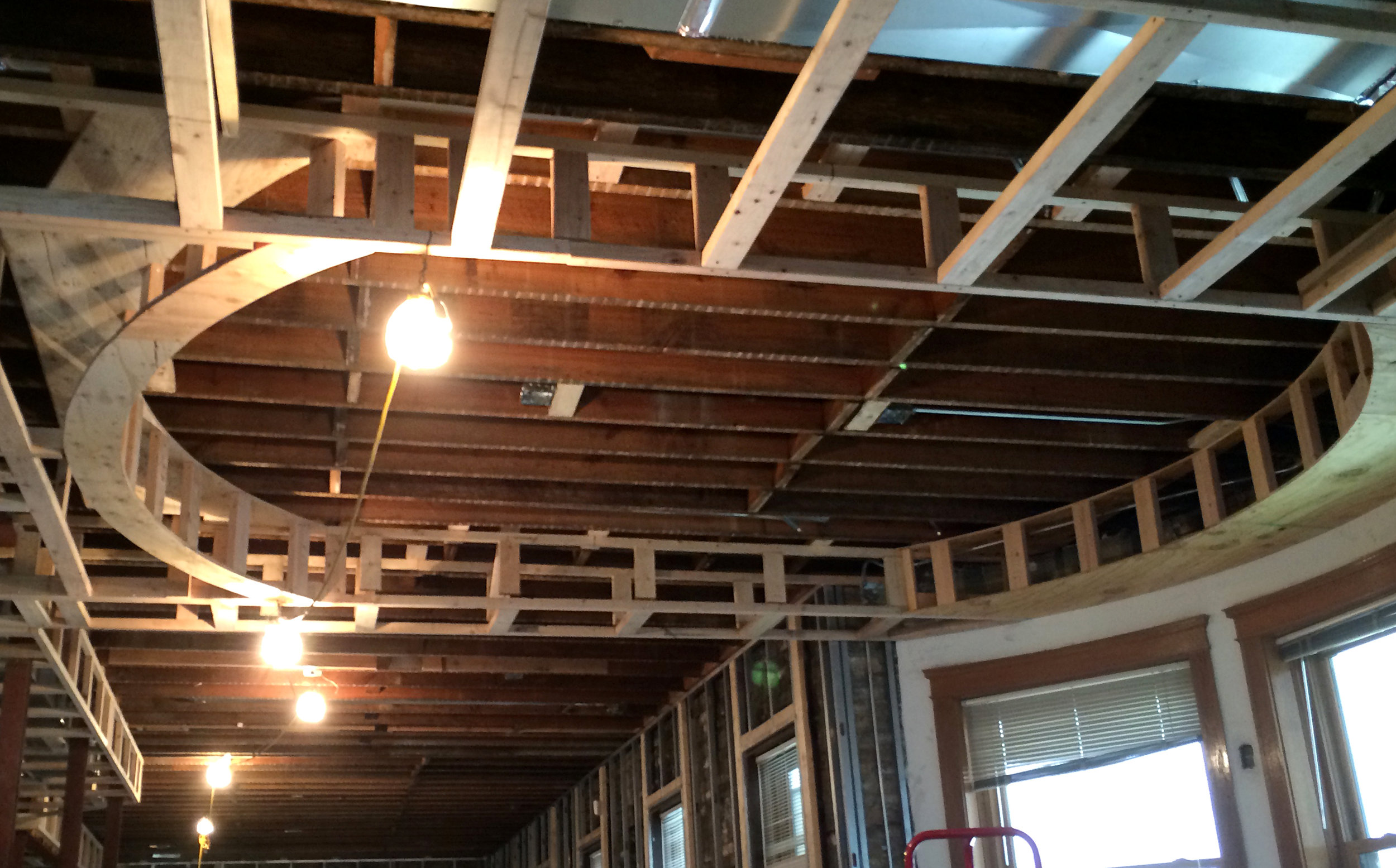 Site visit photo: construction of a drop ceiling with cove lighting above a dining room