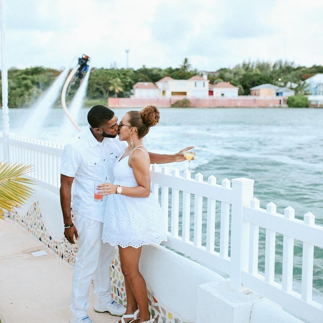 evolve fitness  trainer Charles sealey and girlfriend pose at white party bahamas. a summer event organized by jetlink adventures and  Bahari bahamas .